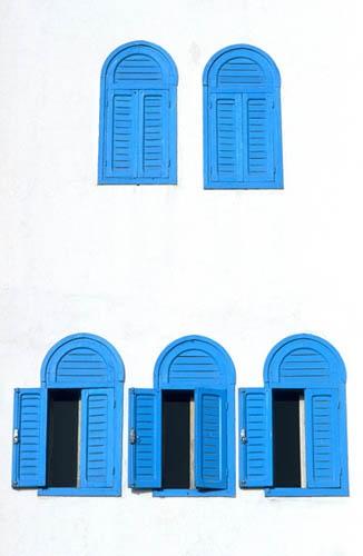 Blue shutters on white house, Essaouira , Morocco by silverygibbon