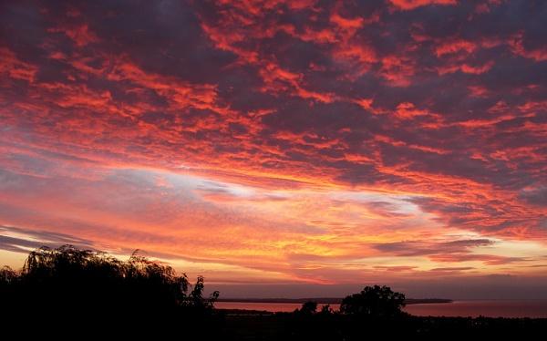 Sunset over Sheppey by hughscott