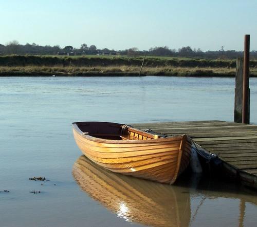 Shiny brown row-boat by jennywren