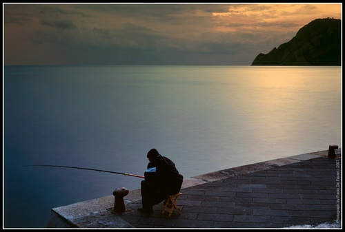 Fishing for dinner. Vernazza, Cinqueterre, Italy. by paolodefaveri