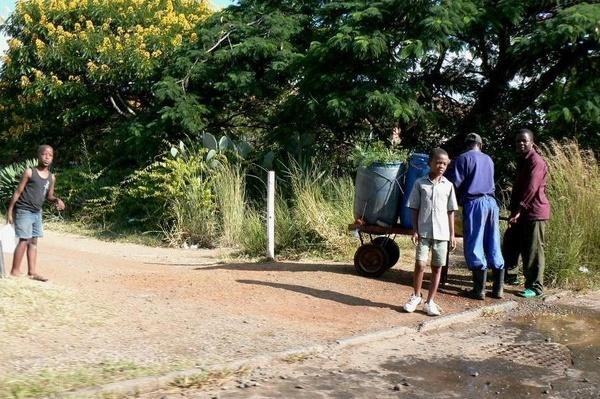Collecting Water in Zimbabwe by Hughmondo
