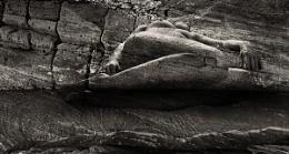 sleeping stone by water edge