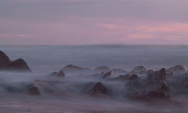 Misty rocks at sunset by lanejay