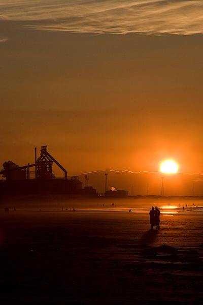 Sunset across Redcar Beach by photodocktor