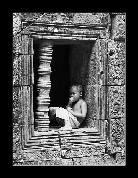 Boy In Window, Ta Som, Cambodia by Skier