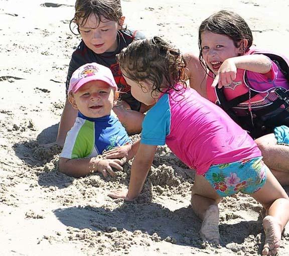 Kids on beach by Apples