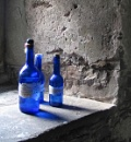 three blue bottles