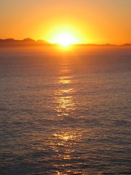 sunset across the ocean by Kitty3