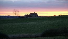 Farmhouse at sunset.