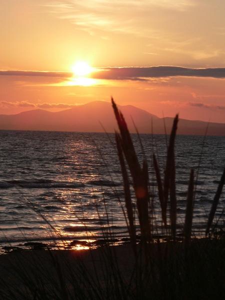 Harlech sunset by mikejmb