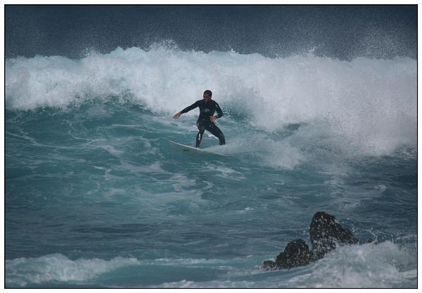 Surfing the reef by geoffrey baker