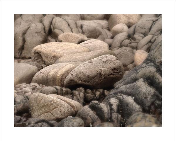 rocks on an atlantic beach by paulmackiemaging
