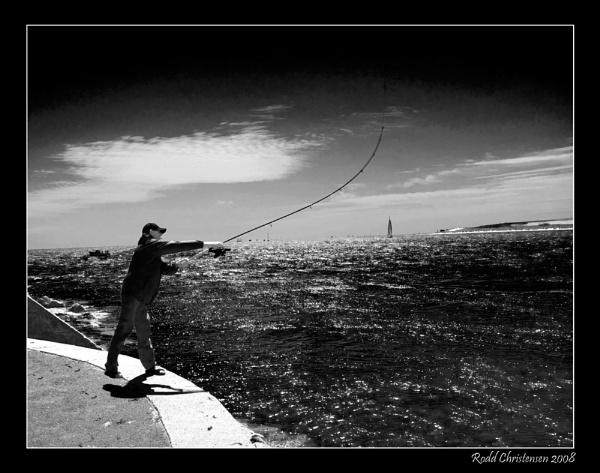 Sandbanks fisherman by RoddBC