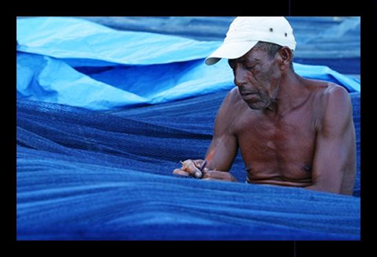 mending fishing nets by gribishok