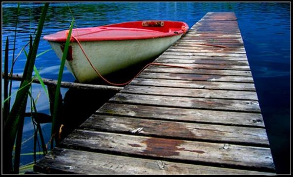 Little boat in big lake by WimdeVos