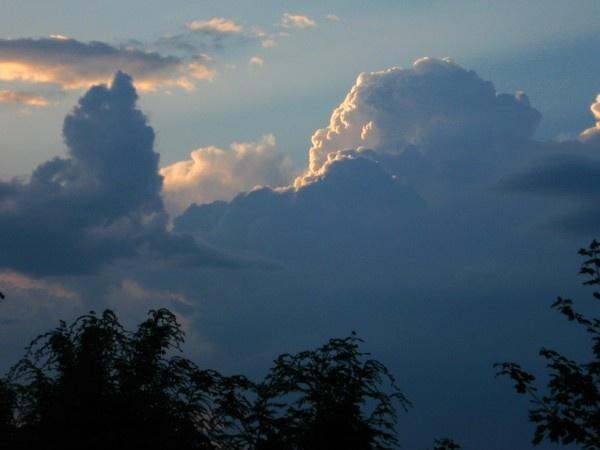Mountainous Sunlit Clouds by ChrisPhotos145