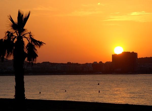 Sunrise over Palamos Spain by RonnieT