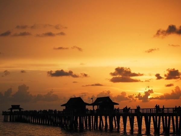 Sunset at Naples, FL pier by Prestidigitator