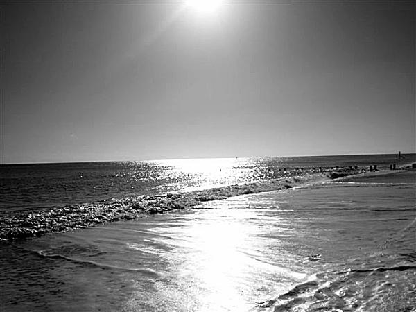 sunrise on the beach by Tomaz