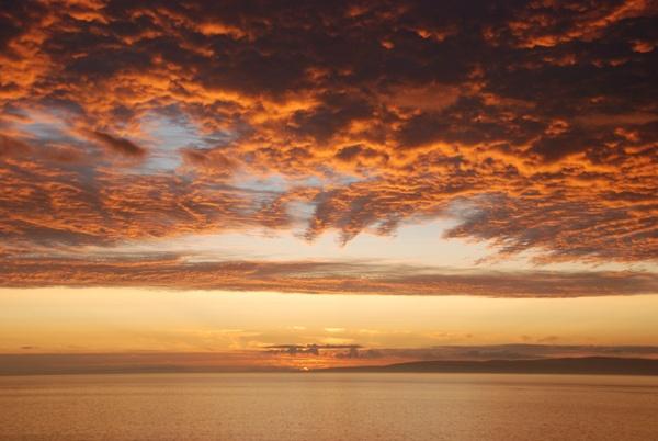sun lit clouds by John45
