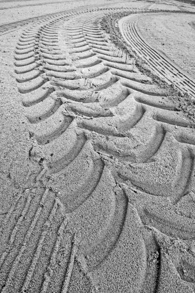 Tracks in the sand...... by HalfBeard