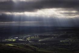 Sunrays across the valley