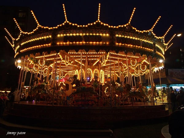 fairground ride at night by jimmypaton