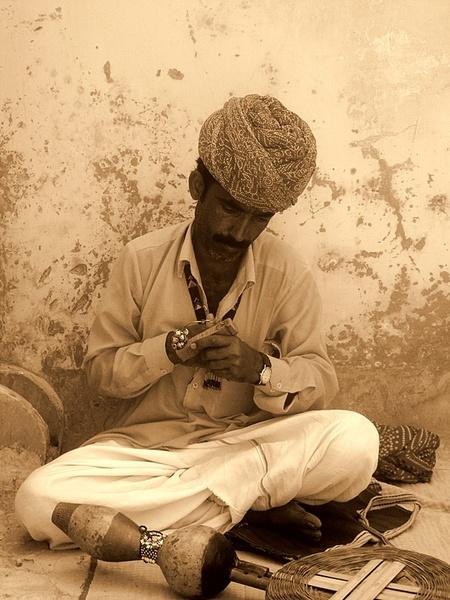 Snake charmer by Manghat