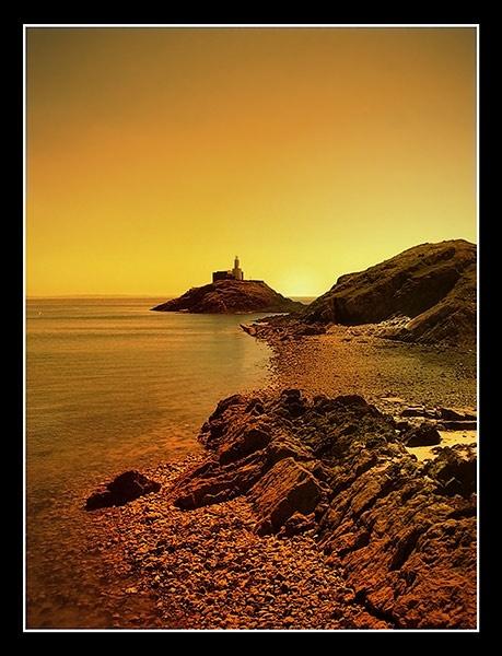 Mumbles Lighthouse by Photogene