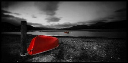 A black and white red boat