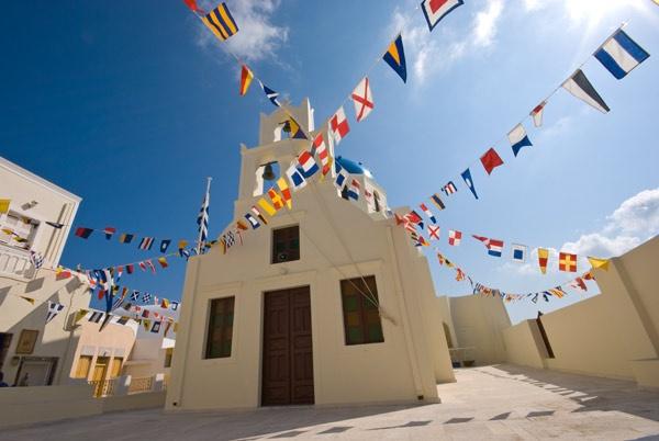 Church Flags.Oia. Santorini. Greece by WILDIMAGES