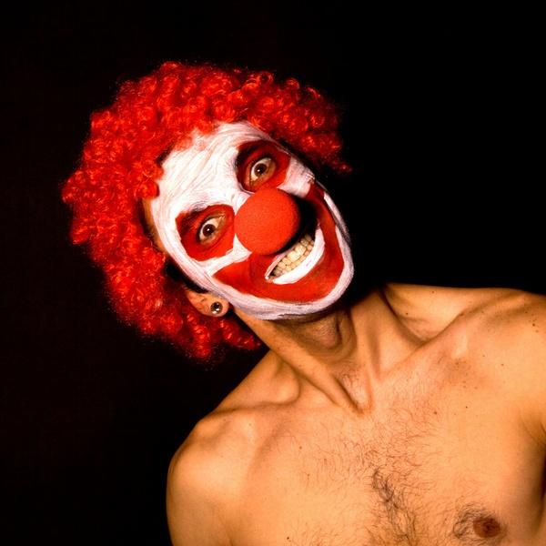 Crazed smiling clown by zimac