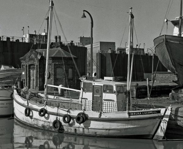 Fishing Boat in Dock by imagio