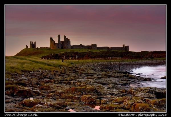 Sunset at Dunstanburgh Castle by IanBurton