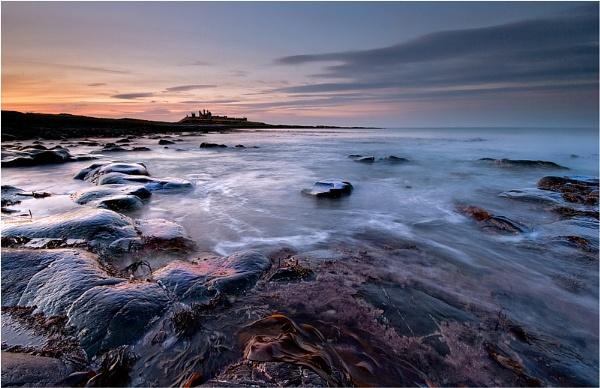 Dunstanburgh Shores by Chant57