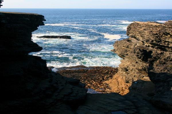 The Irish sea through the rocks by claremaher19