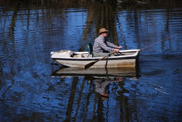 Man rowing by avon