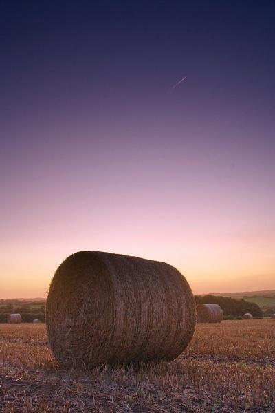 Hay Bale Sunset by DexlaMedia