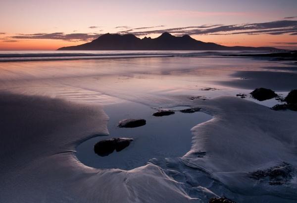 Sunset on Laig beach Eigg by lochaberlight