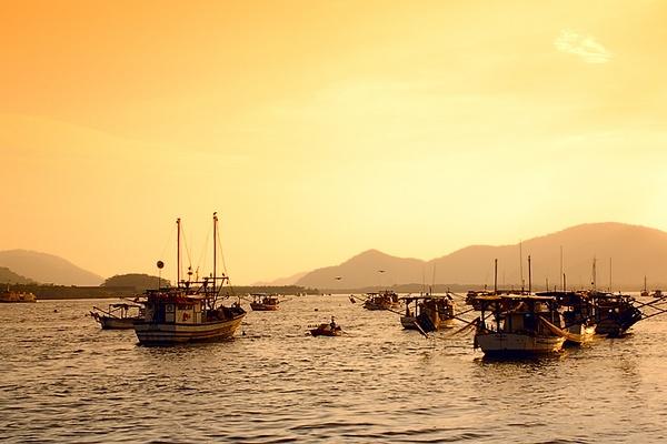 Fishersman port sunset by luizdasilva