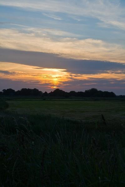 Sunset over St Benet\'s marshes by mlanda