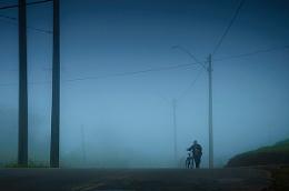 Cyclist in the Fog.