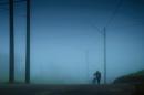Cyclist in the Fog