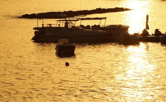 Boats at Sunset by bigwulliemc