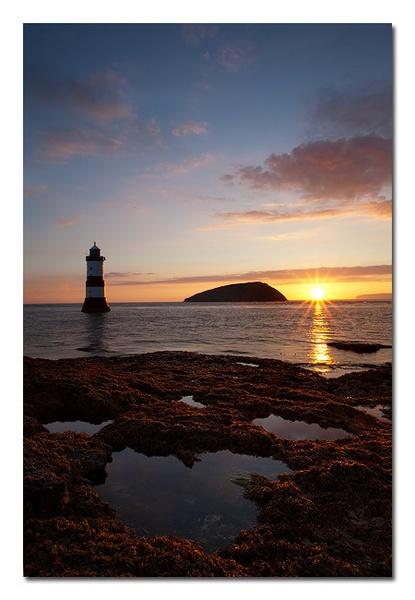Penmon lighthouse sunrise by Guy_Rogers