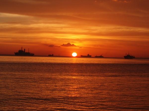 Sunset in Manila Bay by Trojan