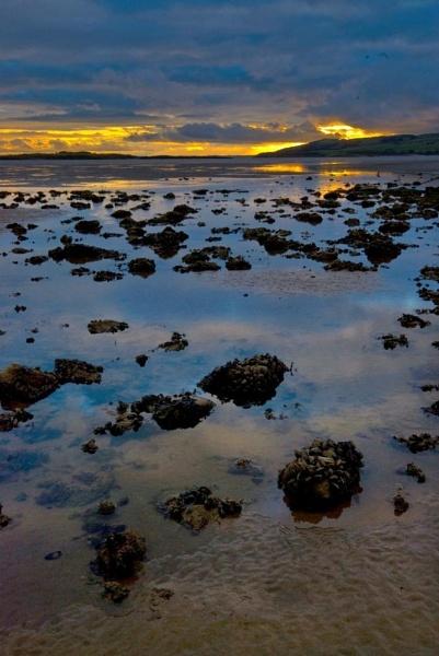 Wet day Sunset by Natzdad