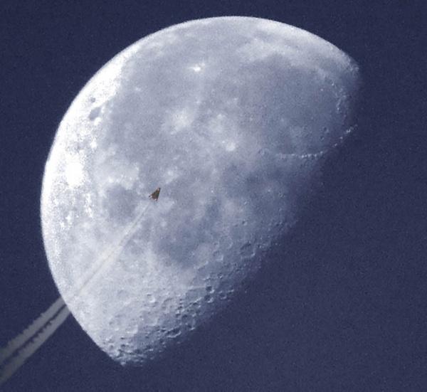 aircraft passing moon by MarkBowker