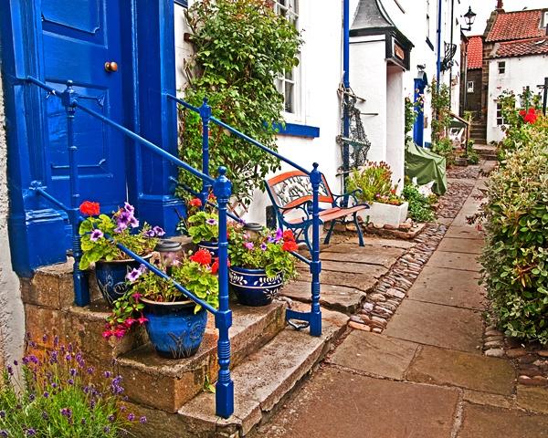 blue door robin hoods bay by stefan