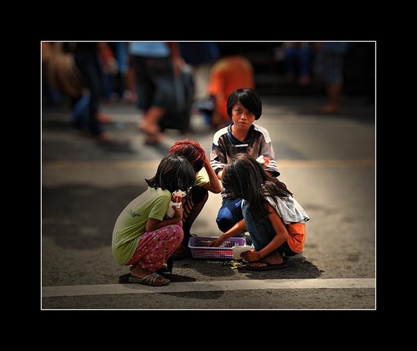 Young Candle Vendors by Saigonkick